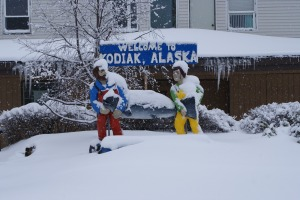 The Welcome to Kodiak sign under a few feet of snow