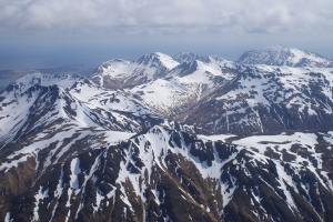 Snow-capped mountains in mid-May of Kodiak Island