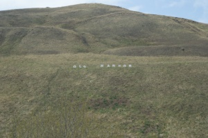 "Old Harbor's ""Hollywood"" hill sign"