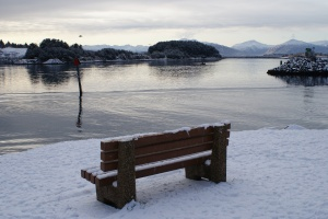 Snowy bench at the Kodiak breakwater in St. Paul Harbor